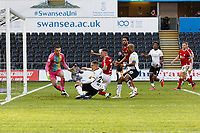 Jake Bidwell of Swansea City (C) challenged by Jack Hunt of Bristol City as he skids towards Daniel Bentley of Bristol City (L) during the Sky Bet Championship match between Swansea City and Bristol City at the Liberty Stadium, Swansea, Wales, UK. Saturday 27 February 2021