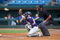 Catcher Satchell Norman (19) of Sarasota HS in Sarasota, FL playing for the Colorado Rockies scout team reaches for a high pitch during the East Coast Pro Showcase at the Hoover Met Complex on August 2, 2020 in Hoover, AL. (Brian Westerholt/Four Seam Images)