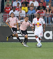 24 June2009: New York Red Bulls midfielder Dane Richards #19 and Toronto FC forward Pablo Vitti #8 battle for a ball while Toronto FC defender Nick Garcia #6 looks on at BMO Field in Toronto, in a game between the New York Red Bulls and Toronto FC. Toronto FC won 2-0..