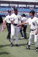 Chicago White Sox Bo Jackson (8) on rehab assignment with the Sarasota White Sox greets manager Rick Patterson (12) circa August 1991 at Ed Smith Stadium in Sarasota, Florida.  (MJA/Four Seam Images)