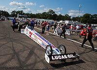 Aug 15, 2014; Brainerd, MN, USA; NHRA top fuel dragster driver Morgan Lucas waits his turn in the staging lanes during qualifying for the Lucas Oil Nationals at Brainerd International Raceway. Mandatory Credit: Mark J. Rebilas-