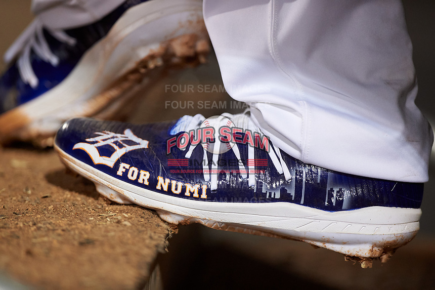 """A detailed look at Mesa Solar Sox pitcher Alex Lange's (32) custom cleats during an Arizona Fall League game against the Peoria Javelinas on September 21, 2019 at Sloan Park in Mesa, Arizona. Lange's cleats were painted with """"For Numi"""" to honor his late teammate Chace Numata who passed on September 2, 2019. Mesa defeated Peoria 4-1. (Zachary Lucy/Four Seam Images)"""