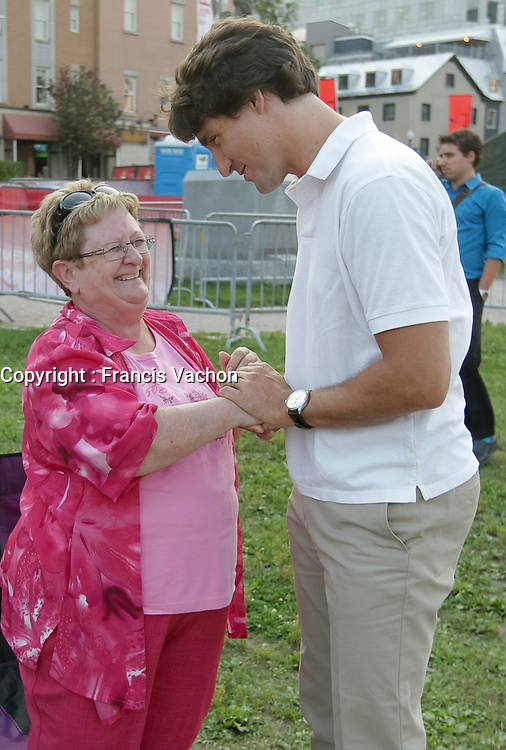 Liberal Party of Canada leader Justin Trudeau chats with Jocelyne Ranger at the Festival de Musique Militaire in Quebec City, Wednesday August 21, 2013.<br /> <br /> PHOTO :  Francis Vachon - Agence Quebec Presse