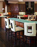 White Upholstered Stools Contrast Dark Wood with cracked glass mirrored counter top