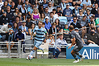 ST. PAUL, MN - AUGUST 21: Johnny Russell #7 of Sporting Kansas City with the ball in front of  Chase Gasper #77 of Minnesota United FC during a game between Sporting Kansas City and Minnesota United FC at Allianz Field on August 21, 2021 in St. Paul, Minnesota.
