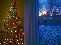 Sunrise outside patio door with christmas tree inside.. From Verizon Droid camera.