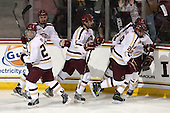 Quinn Smith (BC - 27), Brendan Silk (BC - 9), Chris Calnan (BC - 11), Patrick Brown (BC - 23), Scott Savage (BC - 28) - The Boston College Eagles defeated the visiting University of Wisconsin Badgers 9-2 on Friday, October 18, 2013, at Kelley Rink in Conte Forum in Chestnut Hill, Massachusetts.