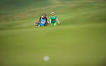 TAOYUAN, TAIWAN - OCTOBER 27:  Inbee Park of South Korea and her caddie Brad Beecher walk on the 17th hole during the day three of the Sunrise LPGA Taiwan Championship at the Sunrise Golf Course on October 27, 2012 in Taoyuan, Taiwan.  Photo by Victor Fraile / The Power of Sport Images