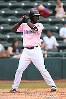 Hickory Crawdads Third baseman Sherten Apostel (13) bats during the game with the Charleston Riverdogs at L.P. Frans Stadium on May 12, 2019 in Hickory, North Carolina.  The Riverdogs defeated the Crawdads 13-5. (Tracy Proffitt/Four Seam Images)