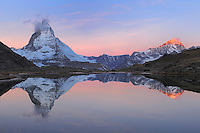 Matterhorn at sunrise in winter with reflection in the Riffelsee, Zermatt, Valais, Switzerland