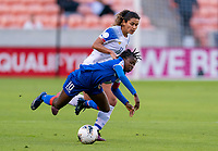 HOUSTON, TX - JANUARY 31: Nerilia Mondesir #10 of Haiti is fouled by Raquel Rodriguez #11 during a game between Haiti and Costa Rica at BBVA Stadium on January 31, 2020 in Houston, Texas.