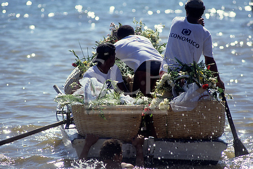 Salvador, Bahia Brazil. Boat with offerings of flowers out to the sea; Festa de Iemanja - Festival of Iemanja (Godness of the sea).