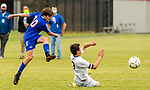 WOODBURY, CT-111120JS21 —Nonnewaug's Zach Hellwinkle (30) fires a shot on goal past a sliding Wolcott Tech's Hunter Jacquemin (3) during their game Wednesday at Nonnewaug High School. <br /> Jim Shannon Republican-American