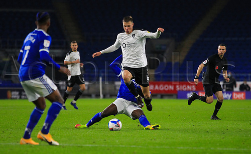 3rd November 2020; Cardiff City Stadium, Cardiff, Glamorgan, Wales; English Football League Championship Football, Cardiff City versus Barnsley; Mads Andersen of Barnsley evades the challenge form Sheyi Ojo of Cardiff City