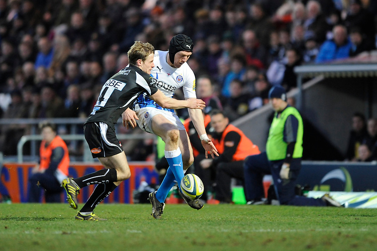 Sam Vesty of Bath Rugby (right) chips ahead as Mark Foster of Exeter Chiefs attempts to block his kick during the LV= Cup match between Exeter Chiefs and Bath Rugby at Sandy Park Stadium on Sunday 5th February 2012 (Photo by Rob Munro)
