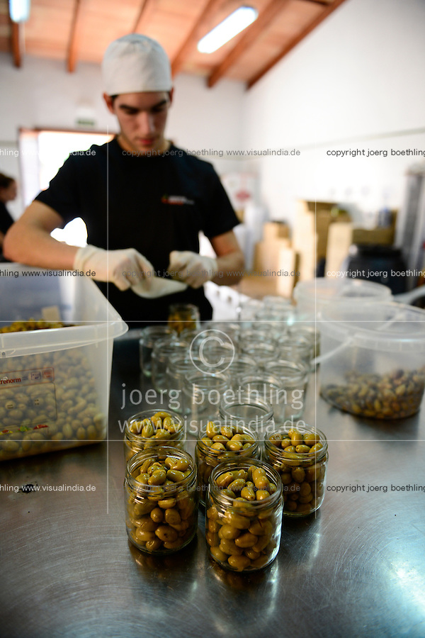 SPAIN Mallorca, Soller, cooperativa agricola de Soller Sant Bartomeu, processing of olives a local product  / SPANIEN Mallorca, Verkauf lokaler Produkte, Oliven