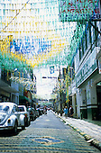 Belem, Amazon, Brazil. Street with plastic bunting in Brazilian colours.