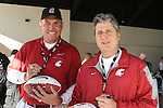 "Former Washington State quarterback, and Super Bowl XXVI MVP, Mark Rypien (left), and Cougar head football coach, Mike Leach, sign autographs during WSU's ""Cougar Legends"" weekend at the Coeur d'Alene Resort in Coeur d'Alene, Idaho, on June 8-9, 2012."