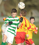 Gary Dunne of Knocklyon FC in action against Jack Stubbs of Avenue United during their SFAI game at Lisdoonvarna. Photograph by John Kelly.