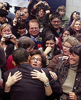 Sen. Barack Obama is embraced by a supporter during a campaign rally at Roosevelt High School in Des Moines on January 1, 2008, just two days before the Iowa cuacuses.