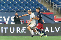 FOXBOROUGH, MA - AUGUST 5: Robert Kristo #11 of North Carolina FC collects a pass as Colin Verfurth #35 of New England Revolution II pressures during a game between North Carolina FC and New England Revolution II at Gillette Stadium on August 5, 2021 in Foxborough, Massachusetts.
