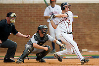 Dan Grovatt #21 of the Virginia Cavaliers follows through on his swing against the VCU Rams at the Charlottesville Regional of the 2010 College World Series at Davenport Field on June 4, 2010, in Charlottesville, Virginia.  The Cavaliers defeated the Rams 14-5.  Photo by Brian Westerholt / Four Seam Images