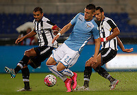 Calcio, Serie A: Lazio vs Udinese. Roma, stadio Olimpico, 13 settembre 2015.<br /> Lazio's Sergej Milinkovic-Savic, center, is challenged by Udinese's Danilo Larangeira, left, and Ali Adnan, during the Italian Serie A football match between Lazio and Udinese at Rome's Olympic stadium, 13 September 2015.<br /> UPDATE IMAGES PRESS/Isabella Bonotto