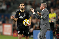 CARSON, CA - SEPTEMBER 15: Sporting Kansas City's head coach Peter Vermes and Graham Zusi #8 during a game between Sporting Kansas City and Los Angeles Galaxy at Dignity Health Sports Complex on September 15, 2019 in Carson, California.