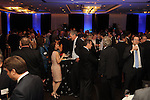 Guests network at the Technip reception at the Hotel Derek Tuesday May 1,2012. (Dave Rossman Photo)