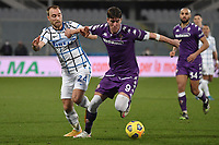 Christian Eriksen of FC Internazionale and Dusan Vlahovic of ACF Fiorentina compete for the ball during the Italy Cup round of 16 football match between ACF Fiorentina and FC Internazionale at Artemio Franchi stadium in Firenze (Italy), January 13th, 2021. Photo Andrea Staccioli / Insidefoto