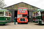 Pictured: James Freeman, Chairman of The Friends of King Alfred Buses polishes the wing mirror of a red 1964 AEC Renown vintage bus no. 596, sandwiched between a green 1950 Leyland Olympic no. 708 and a 1959 Leyland Tiger no. 104 at the bus depot near Romsey, Hants during what would typically be a busy period leading up to the King Alfred Buses Running Day event, which has been cancelled this year due to the coronavirus pandemic. <br /> The annual event, usually held in May sees 20 heritage buses from as early as the 1950s providing free services through the city of Winchester and surrounding villages. <br /> <br /> The Friends of King Alfred Buses have taken the decision to cancel this years event, citing the effects of the coronavirus pandemic and the uncertainty around what kind of public events are permissible in the next few months. <br /> <br /> The vintage buses are still expected to play a part at Winchester Heritage Open Days in September of this year. <br /> <br /> © Jordan Pettitt/Solent News & Photo Agency<br /> UK +44 (0) 2380 458800