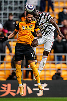 23rd May 2021; Molineux Stadium, Wolverhampton, West Midlands, England; English Premier League Football, Wolverhampton Wanderers versus Manchester United; Eric Bailly of Manchester United and Willian José of Wolverhampton Wanderers clash heads competing for the ball