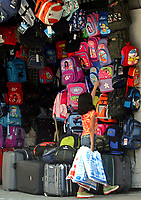 A Palestinian girl looks at school bags in the market in Gaza City, Wednesday, Aug. 29, 2007. (FADY ADWAN)