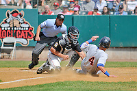 Matt Clark (4) of the Binghamton Mets slides at home plate in front of catcher (22) Matt Koch and Home Plate Umpire Roberto Moreno during a game against the New Britain Rock Cats at New Britain Stadium on June 1, 2014 in New Britain, Connecticut.  New Britain defeated Binghamton 6-1.  (Gregory Vasil/Four Seam Images)
