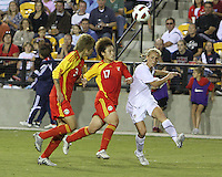 Kristine Lilly #13 of the USA WNT sends over a cross past Fengyue Peng #17 of the PRC WNT during an international friendly match at KSU Soccer Stadium, on October 2 2010 in Kennesaw, Georgia. USA won 2-1.