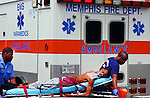 Fri 11, Jun 10 (jsshoot1) Photo by Justin Shaw. Memphis police and Paramedics respond to an afternoon shooting in the Hillcrest apartments in Whitehaven. Police are still searching for the gunman. The victim's name is not being released.