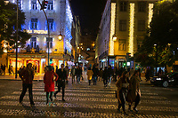 Lisbon, Portugal - December 23:  People are seen walking near Comercio square in downtown Lisbon, Portugal December 23, 2019. <br /> The Christmas lights in Lisbon are getting more sophisticated and stunning each time, they are an attraction to locals and tourists to choose Lisbon as a place to spend the holidays<br /> (Photo by Luis Boza/VIEWpress/Corbis via Getty Images)