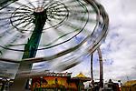 Carnival Rides on Midway at State Fair.  Western Washington State Fair, Puyallup, Washington, USA.
