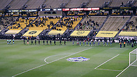 COLUMBUS, OH - DECEMBER 12: The match officials and starters for both teams march onto the field in single file as a precaution against Covid-19 before a game between Seattle Sounders FC and Columbus Crew at MAPFRE Stadium on December 12, 2020 in Columbus, Ohio.