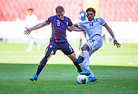 GUADALAJARA, MEXICO - MARCH 28: Djordje Mihailovic #8 of the United States does battle with Joseph Rosales #14 of Honduras during a game between Honduras and USMNT U-23 at Estadio Jalisco on March 28, 2021 in Guadalajara, Mexico.