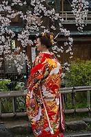 Japan, Kyoto. Woman in red wedding kimono.