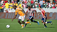 CARSON, CA - March 11, 2012: Houston Dynamo midfielder Je-Vaughn Watson (10), Chivas USA midfielder's Oswaldo Minda (8) and Nick LaBrocca (10) during the Chivas USA vs Houston Dynamo match at the Home Depot Center in Carson, California. Final score Houston Dynamo 1, Chivas USA 0.