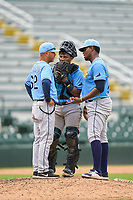 FCL Rays pitching coach Alberto Bastardo (62) talks with catcher Mario Fernandez (59) and pitcher Aneudy Cortorreal (73) during a game against the FCL Pirates Gold on July 26, 2021 at LECOM Park in Bradenton, Florida. (Mike Janes/Four Seam Images)