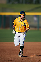 AZL Athletics Gold Rafael Rincones (8) rounds the bases after hitting a home run in the first inning of an Arizona League game against the AZL Rangers on July 15, 2019 at Hohokam Stadium in Mesa, Arizona. The AZL Athletics Gold defeated the AZL Athletics Gold 9-8 in 11 innings. (Zachary Lucy/Four Seam Images)