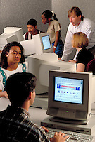 Instructor w  students in computer lab.