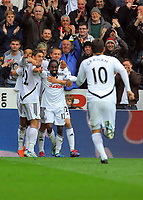 FAO SPORTS PICTURE DESK<br /> Pictured: Nathan Dyer of Swansea with his arms spread out celebrating his goal, surrounded by team mates and Danny Graham (10) Saturday, 14 April 2012<br /> Re: Premier League football, Swansea City FC v Blackburn Rovers at the Liberty Stadium, south Wales.