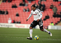 Pictured: Ashley Williams of Swansea. Saturday 07 January 2012<br /> Re: FA Cup football Barnsley FC v Swansea City FC at the Oakwell Stadium, south Yorkshire.