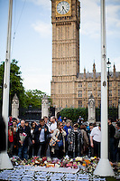 London, 17/06/2016. Today, members of the public gathered in Parliament square to hold a vigil to pay tribute to Jo Cox, the Labour Member of Parliament who was brutally killed by the far-right extremist Thomas Mair on the 16th of June 2016. From Wikipedia.org: <<On 16 June 2016, Jo Cox, the British Labour Party Member of Parliament for Batley and Spen, was shot and stabbed multiple times in Birstall, West Yorkshire, England, shortly before she was due to hold a constituency surgery. A 52-year-old man with a history of mental illness, Thomas Mair, was arrested in connection with Cox's death and subsequently charged with murder and other offences. The incident was the first killing of a sitting British MP since the death of Ian Gow in 1990. […]>>.<br /> <br /> For more information please click here: https://en.wikipedia.org/wiki/Death_of_Jo_Cox & http://www.bbc.co.uk/news/uk-england-36550304