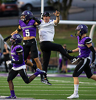Owen Mccone (5) of Fayetteville and head coach celebrate celebrate after interception at Harmon Field , AR, on Friday,September 10, 2021 / Special to NWADG David Beach
