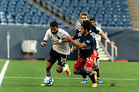 FOXBOROUGH, UNITED STATES - MAY 28: Shaan Hundal #10 of Fort Lauderdale CF dribbles as Ryan Spaulding #34 of New England Revolution II pressures during a game between Fort Lauderdale CF and New England Revolution II at Gillette Stadium on May 28, 2021 in Foxborough, Massachusetts.